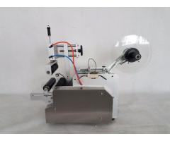 Automatic pneumatic round bottle labeling machine