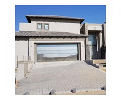 Aluminium glass garage doors and gates