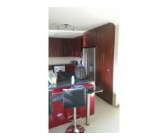 Kitchen units and solid wooden floors