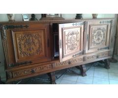 Solid oakwood cabinet with 3 panelled and carved doors with 3 drawers on carved paw feet.