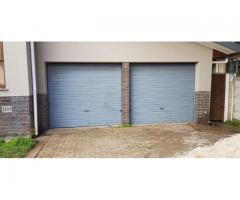 2 tip up meranti wooden doors